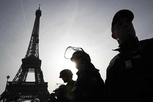 Police Officers Stand in Front of Eiffel Tower