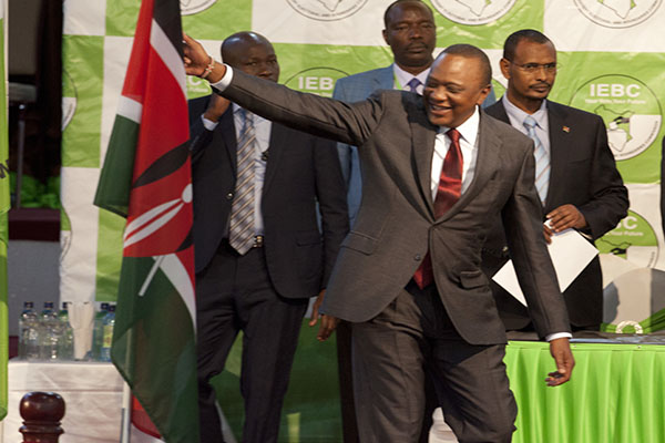 Kenyatta touches the Kenya flag when the results are announced