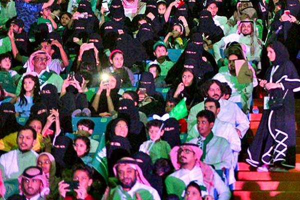 Families in a sports stadium in Saudi Arabia