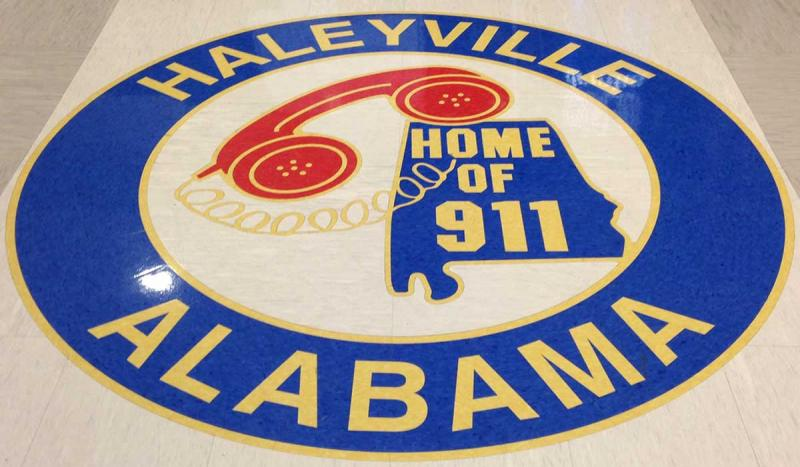 The country's first 911 phone system went into service in Haleyville, Ala.