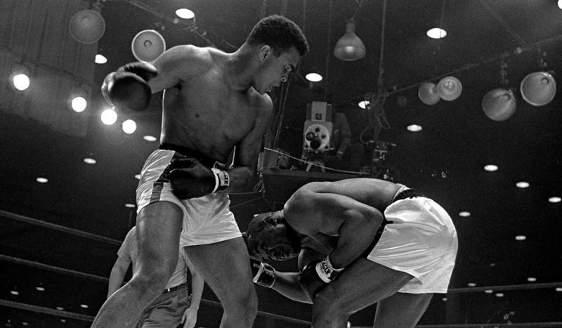Cassius Clay (Muhammad Ali) became world heavyweight boxing champion for the first time by knocking