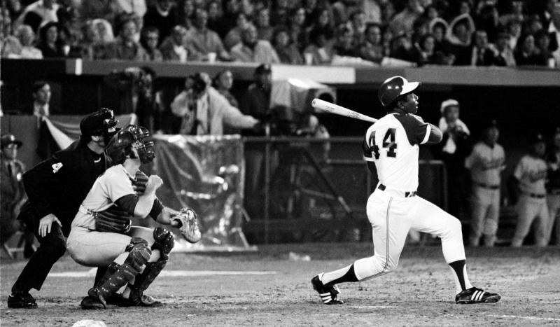 "Henry ""Hank"" Aaron hit the 715th home run of his career, breaking Babe Ruth's record."