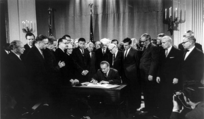President Lyndon B. Johnson signed the 1968 Civil Rights Act.