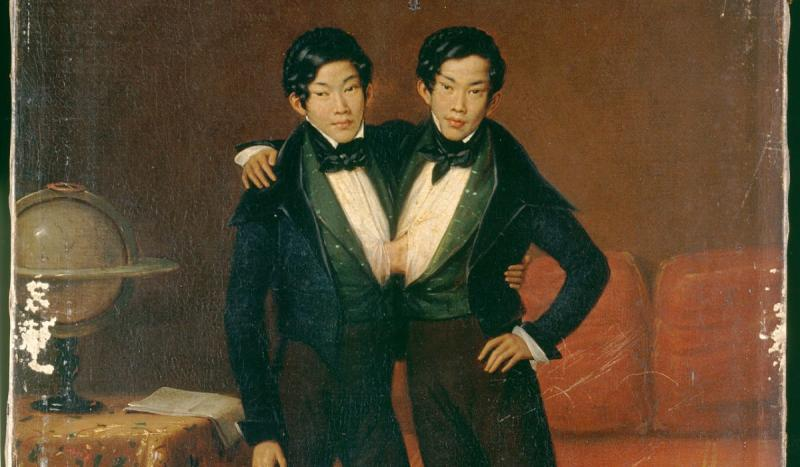 The original Siamese twins, Eng and Chang, arrived in Boston.