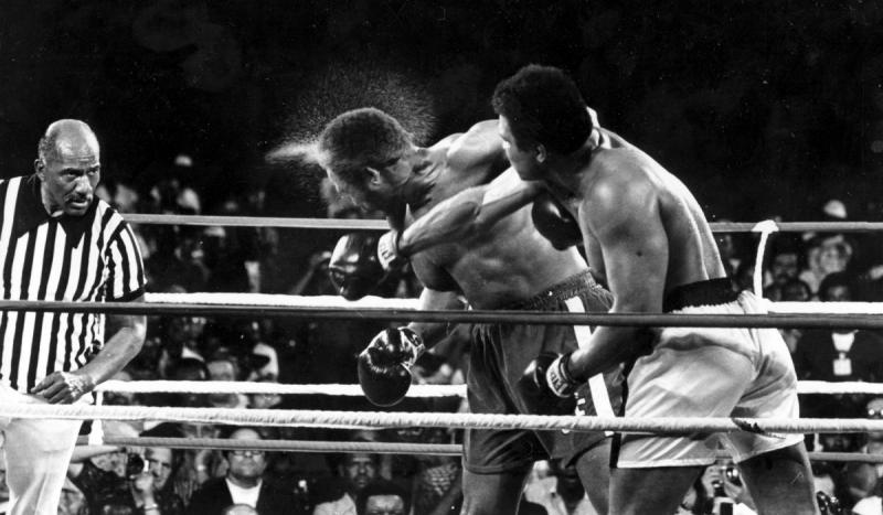 Muhammad Ali knocked out George Foreman in the eighth round of a 15-round bout in Kinshasa, Zaire (""